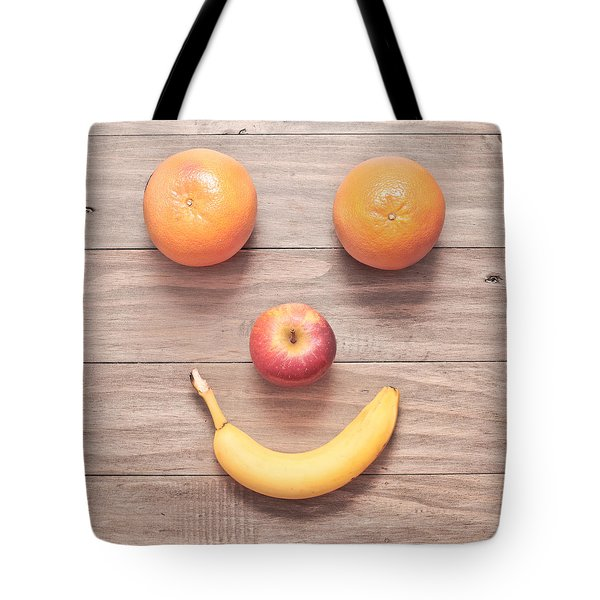 Fruit Face Tote Bag by Tom Gowanlock