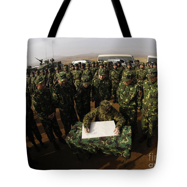 General Peter Pace Signs A Message Tote Bag by Stocktrek Images