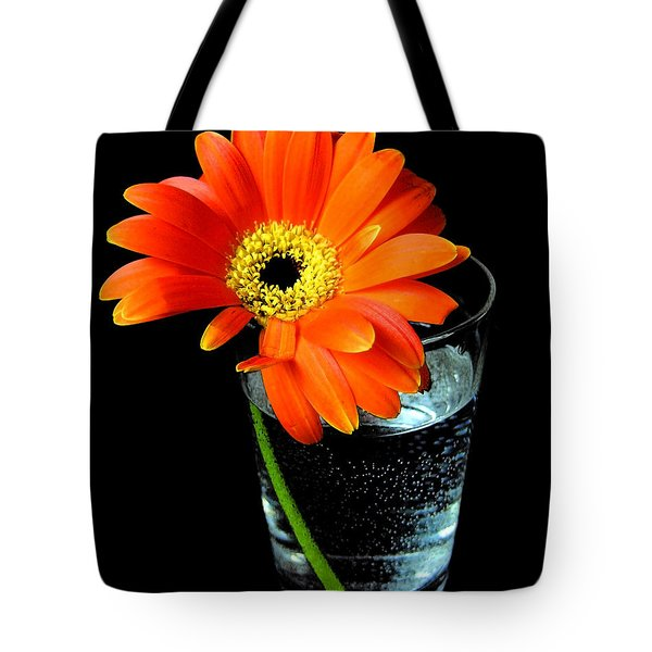 Tote Bag featuring the photograph Gerbera Daisy In Glass Of Water by Nina Ficur Feenan