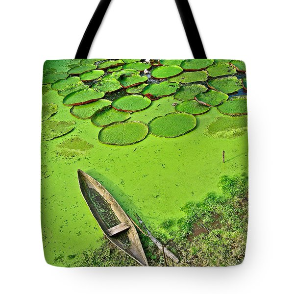 Giant Water Lilies And A Dugout Canoe In Amazon Jungle-peru Tote Bag
