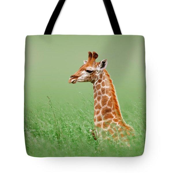 Giraffe Lying In Grass Tote Bag