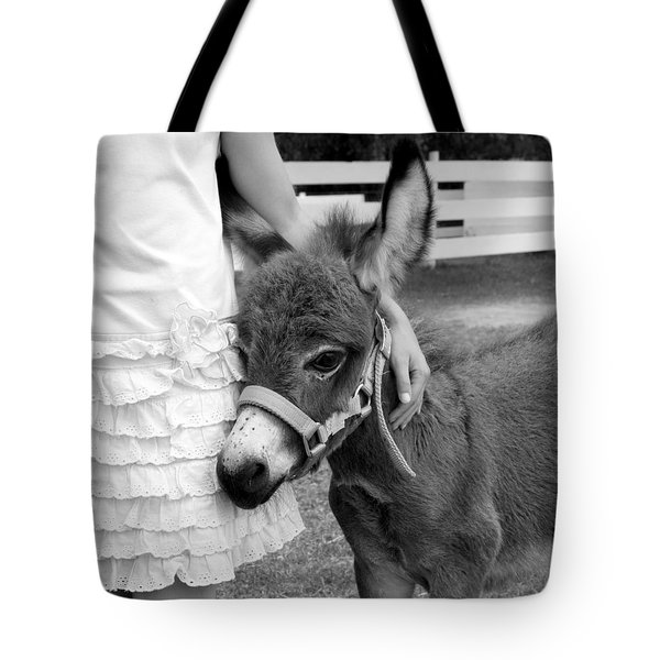 Tote Bag featuring the photograph Girl And Baby Donkey by Brooke T Ryan