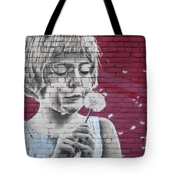 Girl Blowing A Dandelion Tote Bag