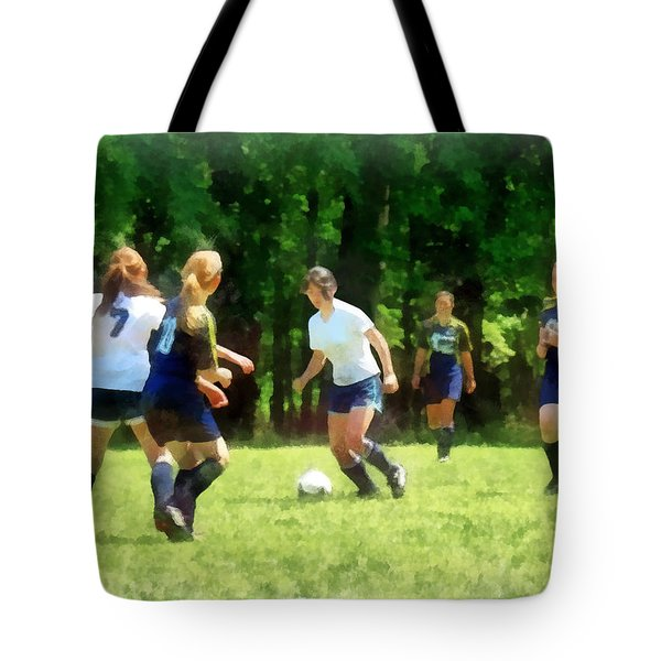 Girls Playing Soccer Tote Bag by Susan Savad