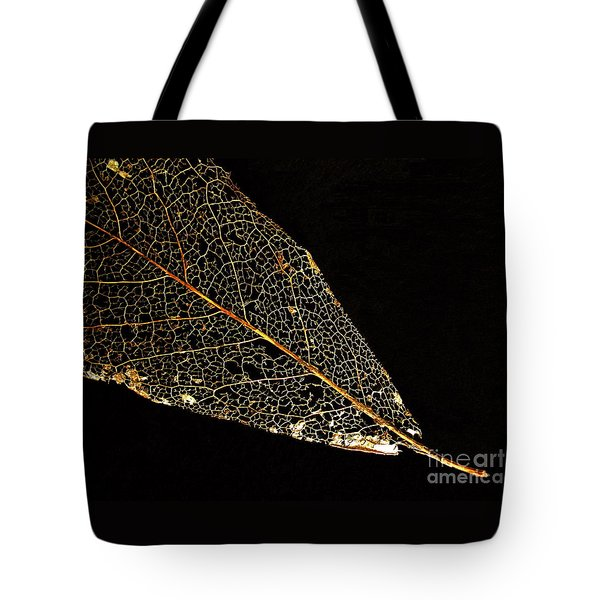 Tote Bag featuring the photograph Gold Leaf by Ann Horn