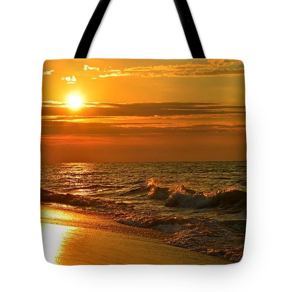 Golden Sunrise Colors With Waves And Horizon Clouds On Navarre Beach Tote Bag by Jeff at JSJ Photography