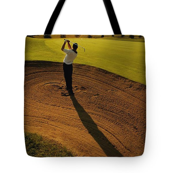Golfer Taking A Swing From A Golf Bunker Tote Bag by Darren Greenwood