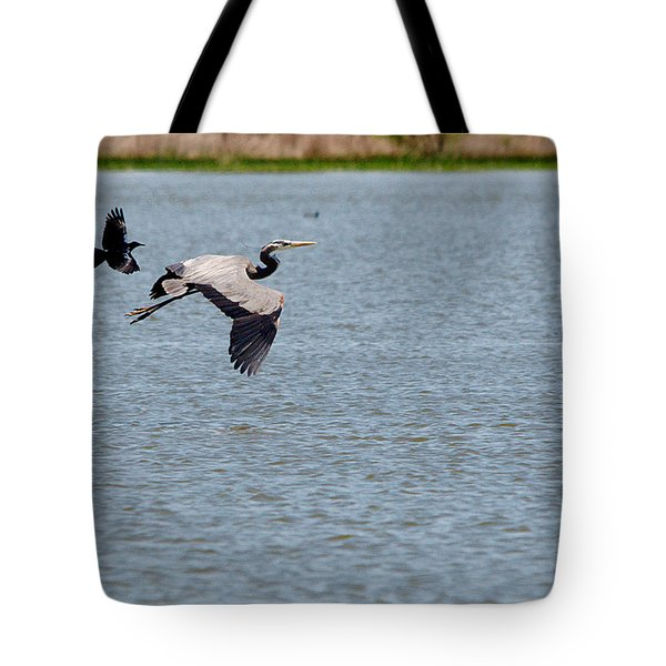 Great Blue Chased By A Grackle Tote Bag by Roy Williams