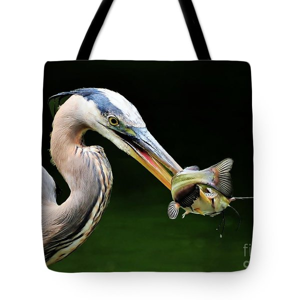 Great Blue Heron And The Catfish Tote Bag