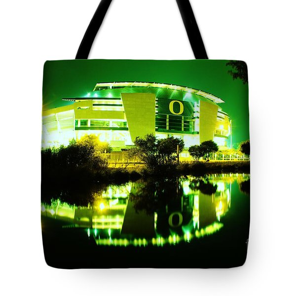 Green Power- Autzen At Night Tote Bag by Michael Cross