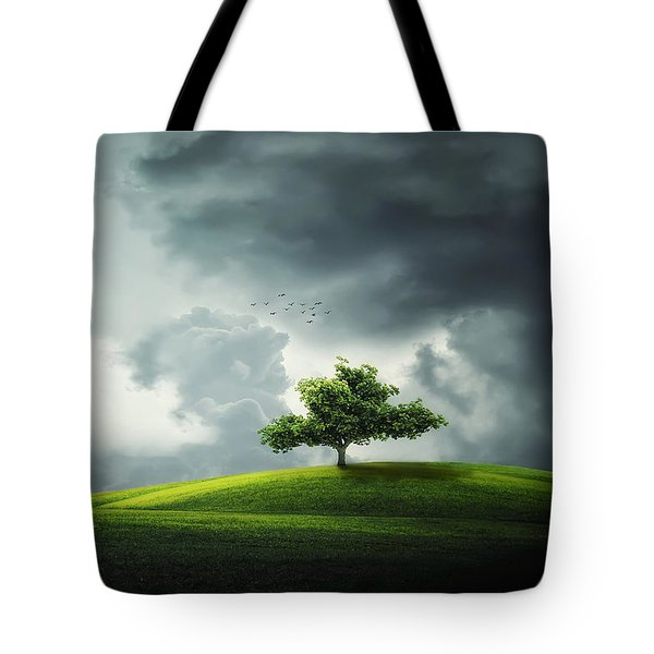 Grey Clouds Over Field With Tree Tote Bag