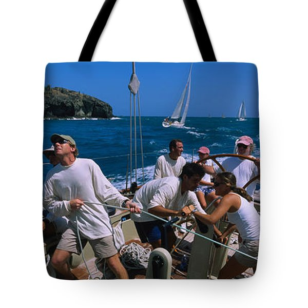 Group Of People Racing In A Sailboat Tote Bag