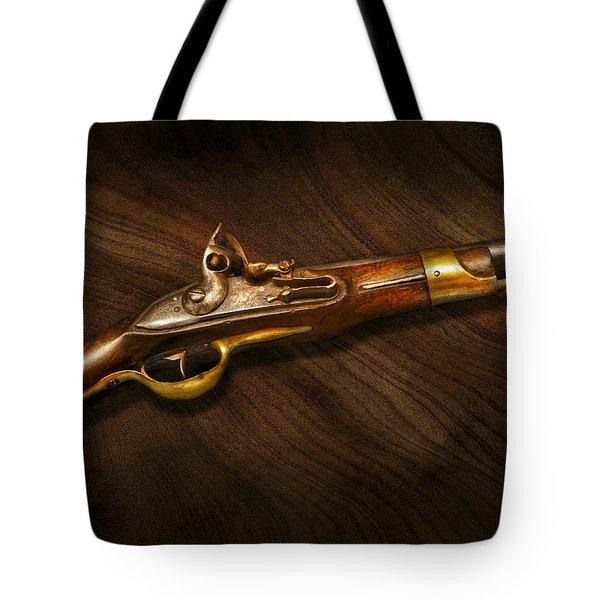 Gun - Pistols At Dawn Tote Bag by Mike Savad