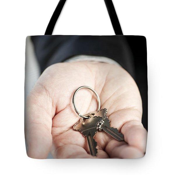 Hand Offering New Keys Tote Bag by Elena Elisseeva
