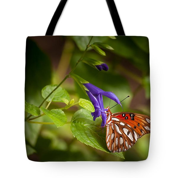 Tote Bag featuring the photograph Hanging On by Penny Lisowski