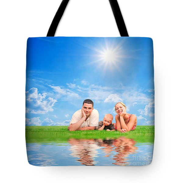 Happy Family Together On Grass Tote Bag by Michal Bednarek