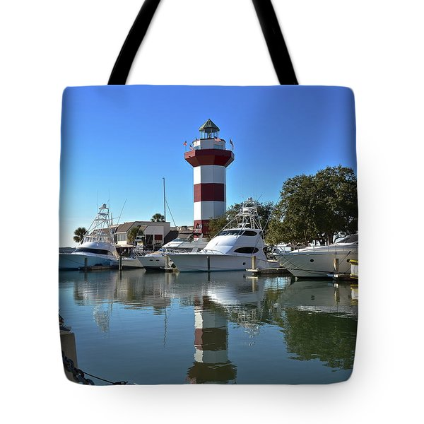 Harbor Town Lighthouse Tote Bag by Carol  Bradley