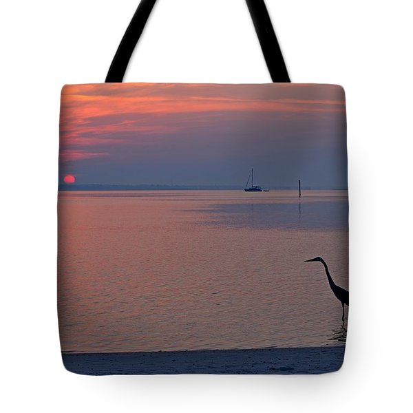 Tote Bag featuring the photograph Harry The Heron Fishing On Santa Rosa Sound At Sunrise by Jeff at JSJ Photography