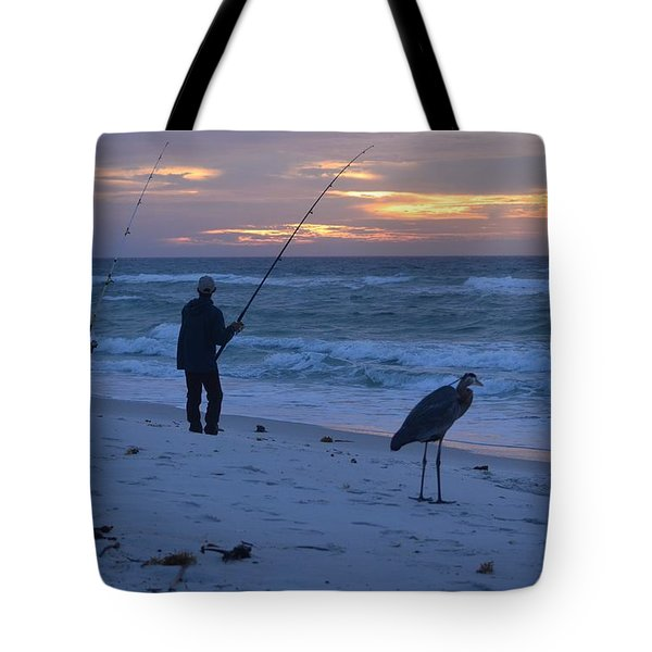 Tote Bag featuring the photograph Harry The Heron Fishing With Fisherman On Navarre Beach At Sunrise by Jeff at JSJ Photography