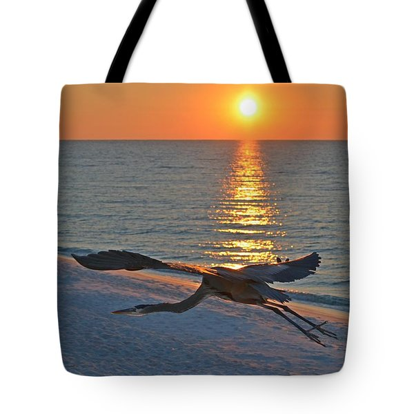 Tote Bag featuring the photograph Harry The Heron Takes Flight To Reposition His Guard Over Navarre Beach At Sunrise by Jeff at JSJ Photography