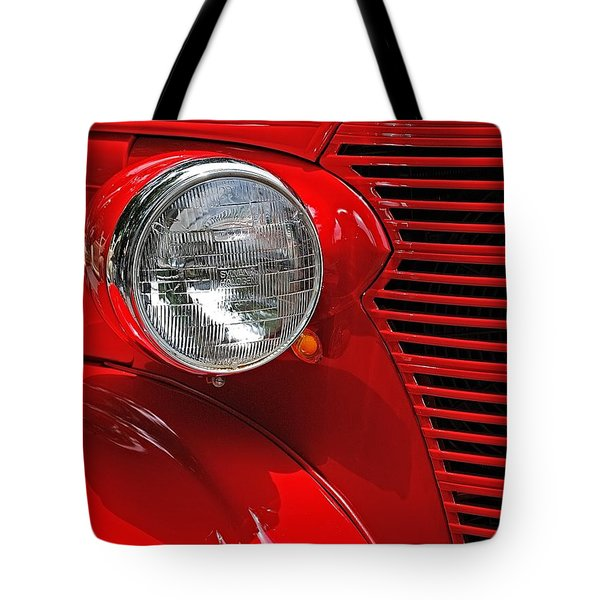 Headlight On Red Car Tote Bag