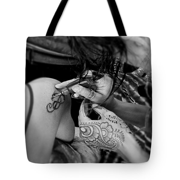 Tote Bag featuring the photograph Henna Artist At Work by Jennie Breeze