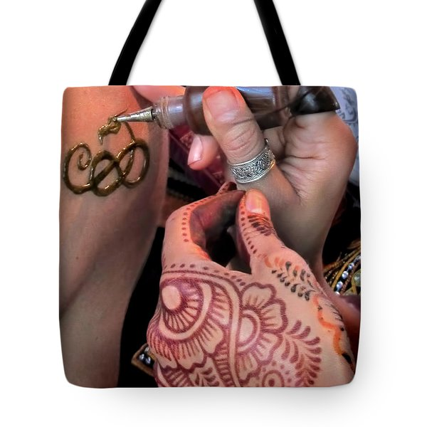 Tote Bag featuring the photograph Henna Hands At Work by Jennie Breeze