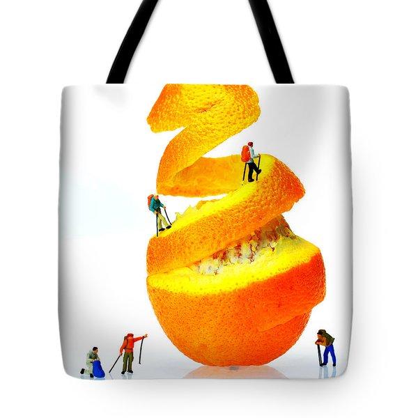 Hikers Climbing Orange Mountain Tote Bag by Paul Ge