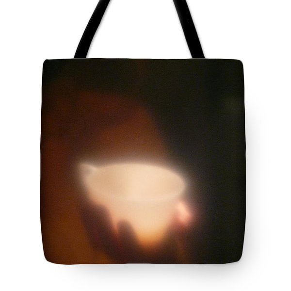 Tote Bag featuring the photograph Holding The Light by Evelyn Tambour
