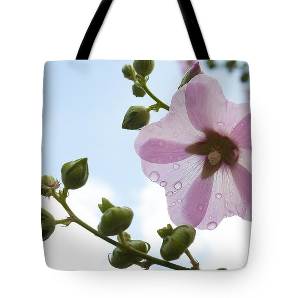 Tote Bag featuring the photograph Hollyhock With Raindrops by Lana Enderle
