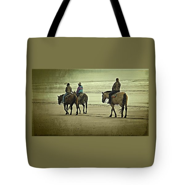 Tote Bag featuring the photograph Horseback Riding On The Beach by Thom Zehrfeld