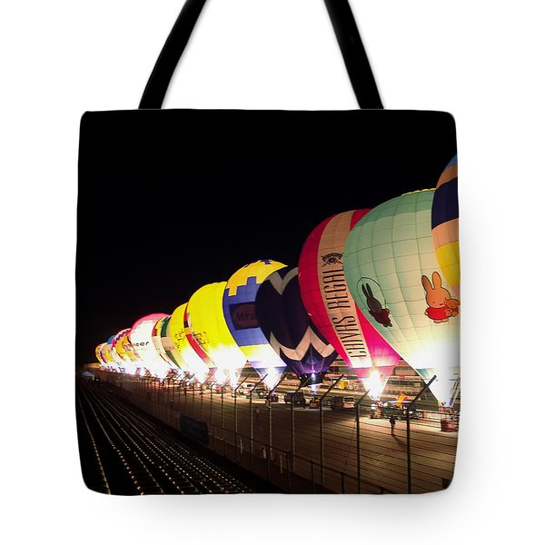 Tote Bag featuring the photograph Balloon Glow by John Swartz