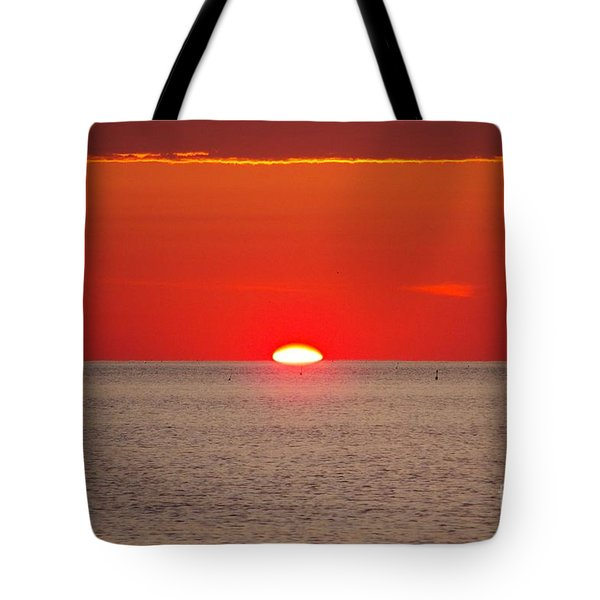 Hot Sun Seems To Melt Into The Sea Tote Bag by Eunice Miller