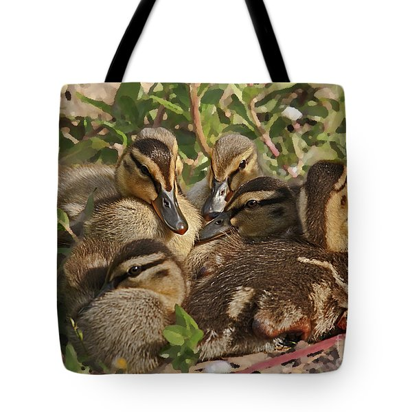 Tote Bag featuring the photograph Huddled Ducklings by Kate Brown