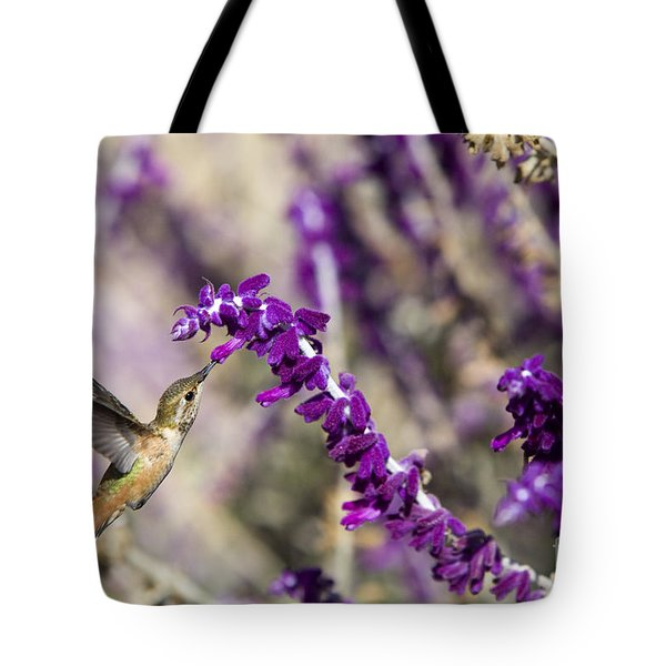 Tote Bag featuring the photograph Hummingbird Collecting Nectar by David Millenheft