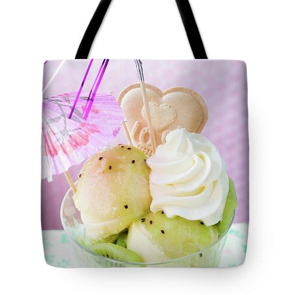 Ice Cream Sundae With Kiwi Fruit, Cream And Cocktail Umbrella Tote Bag