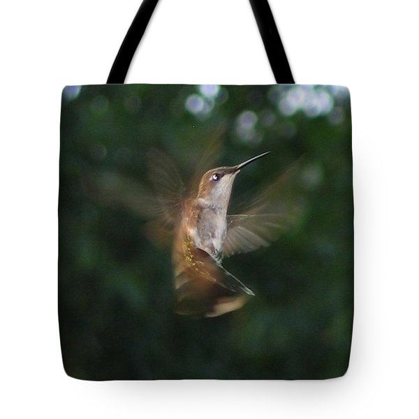 Tote Bag featuring the photograph In Flight by Photographic Arts And Design Studio