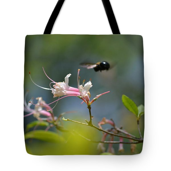 Tote Bag featuring the photograph In Flight by Tara Potts