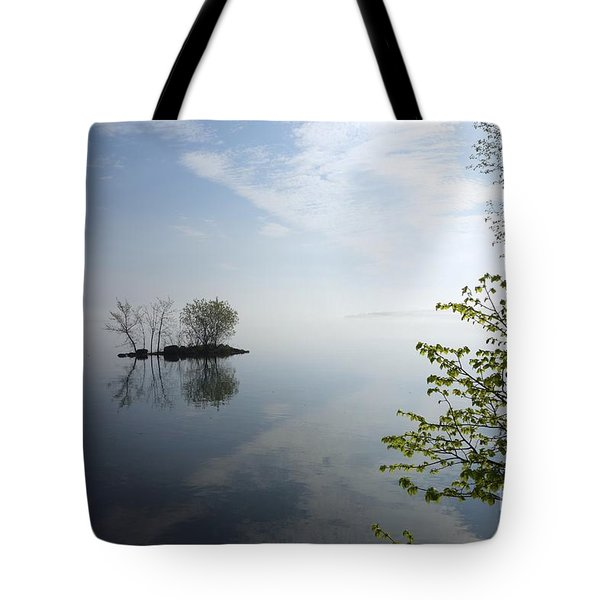 Tote Bag featuring the photograph In The Distance On Mille Lacs Lake In Garrison Minnesota by Jacqueline Athmann