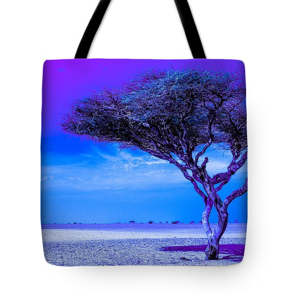 Tote Bag featuring the photograph In The Middle Of Nowhere Under A Purple Sky by Julis Simo