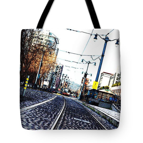 In The Path Of A Cable Car Tote Bag by Holly Blunkall