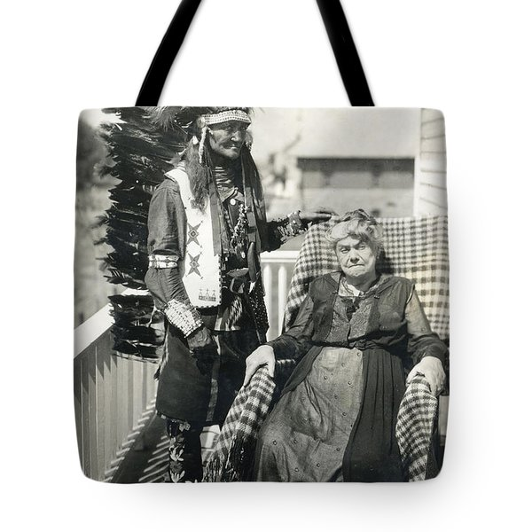 Tote Bag featuring the photograph Indian Chief And Woman by Charles Beeler