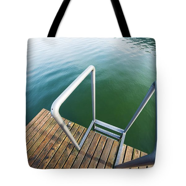 Tote Bag featuring the photograph Into The Water by Chevy Fleet
