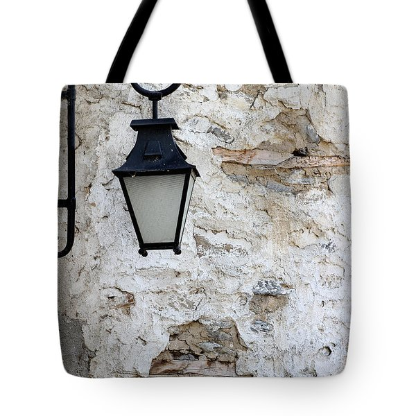 Iron Lantern On A Old Brick Wall Tote Bag by Kamen Zagorov