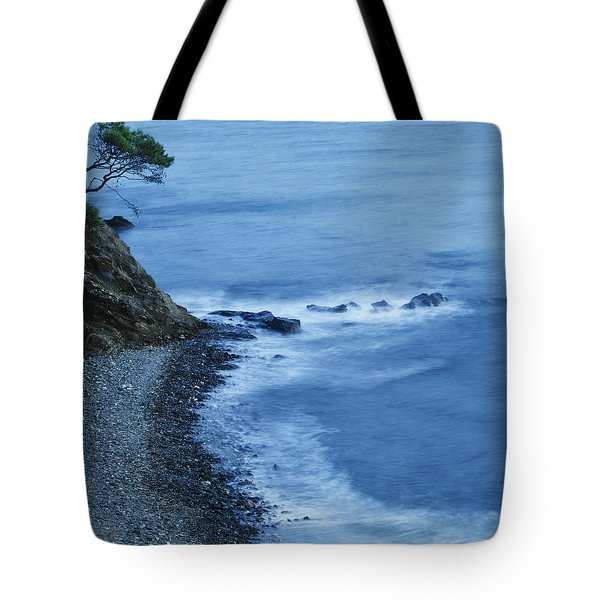 Isolated Tree On A Cliff Overlooking A Tote Bag by Ken Welsh