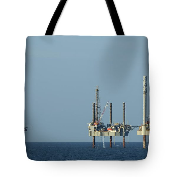 Tote Bag featuring the photograph Jack Up Well Platforms by Bradford Martin