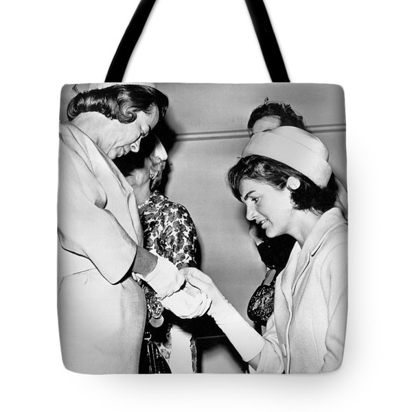 Jackie Inspects Gold Bracelet Tote Bag by Underwood Archives