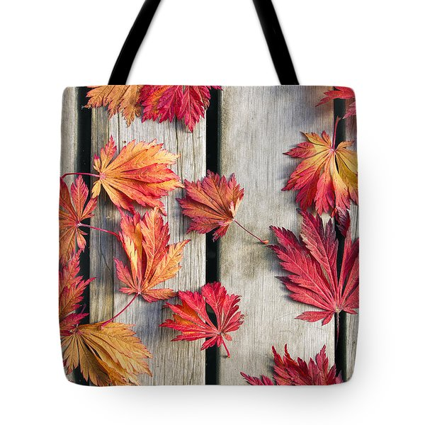 Japanese Maple Tree Leaves On Wood Deck Tote Bag