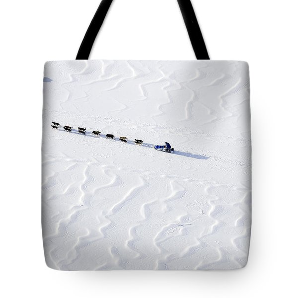 John Bakers Team Running Down Frozen Yukon River  Tote Bag by Jeff Schultz