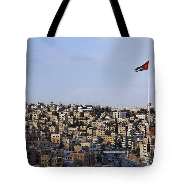 Jordanian Flag Flying Over The City Of Amman Jordan Tote Bag by Robert Preston